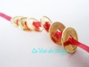 Money Magnet 6 Coins on Red Ribbon